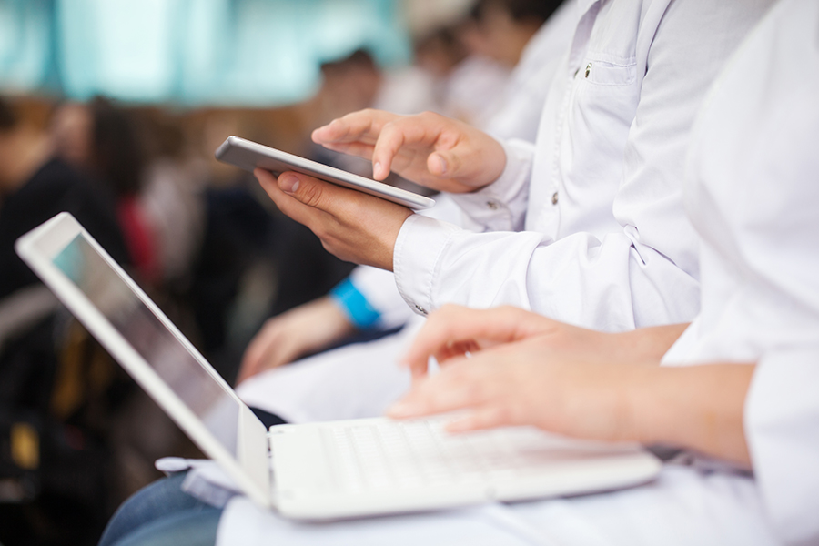 medical students or doctors using digital tablet and laptop