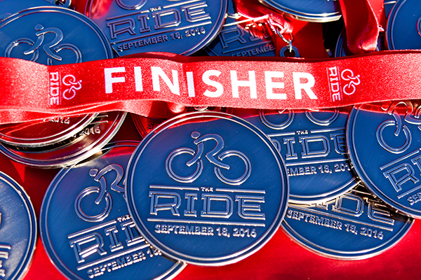 Finisher medals from The Ride Fundraiser