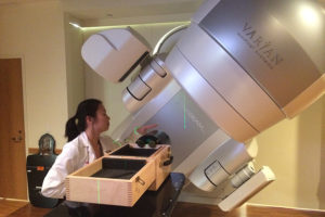 Jessie Huang-Vredevoogd preparing for image quality QA on a Varian TrueBeam STx.