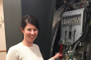 Kate Mittauer inspecting internal components of ViewRay system. Late 2015.