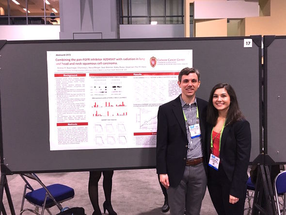Andrew Baschnagel and student at poster presentation AACR 2017