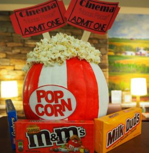 decorated pumpkin, bag of popcorn