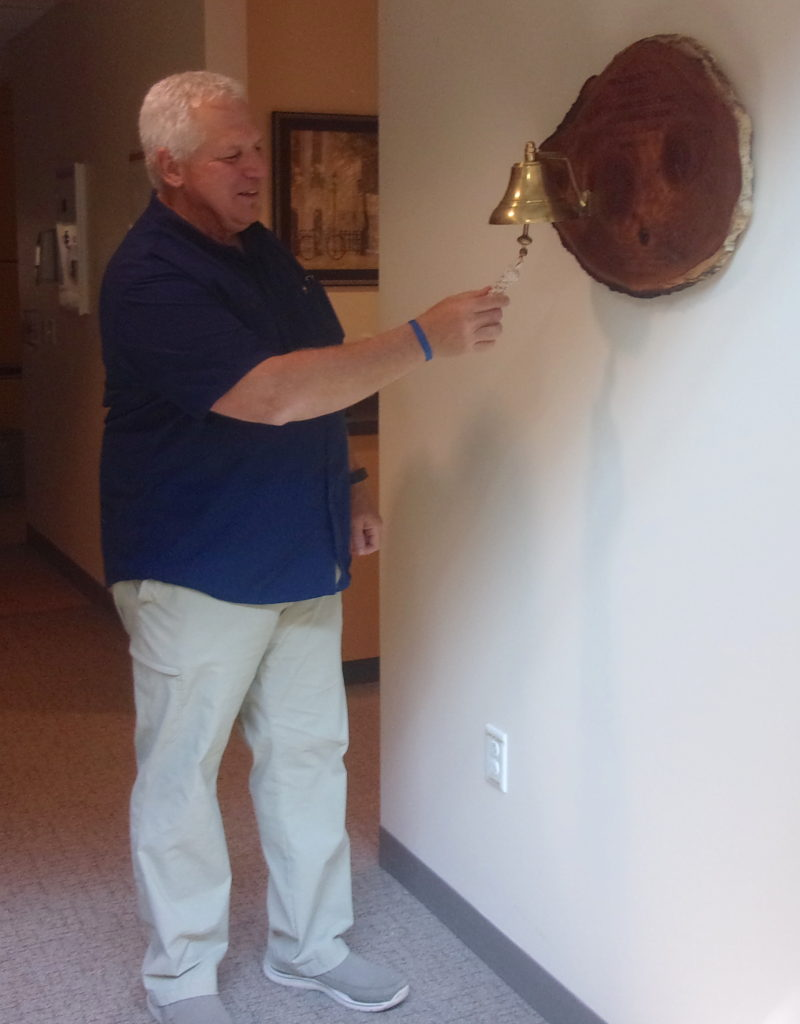 Brad Glassel rings end-of-treatment bell at UW Cancer Center–Johnson Creek