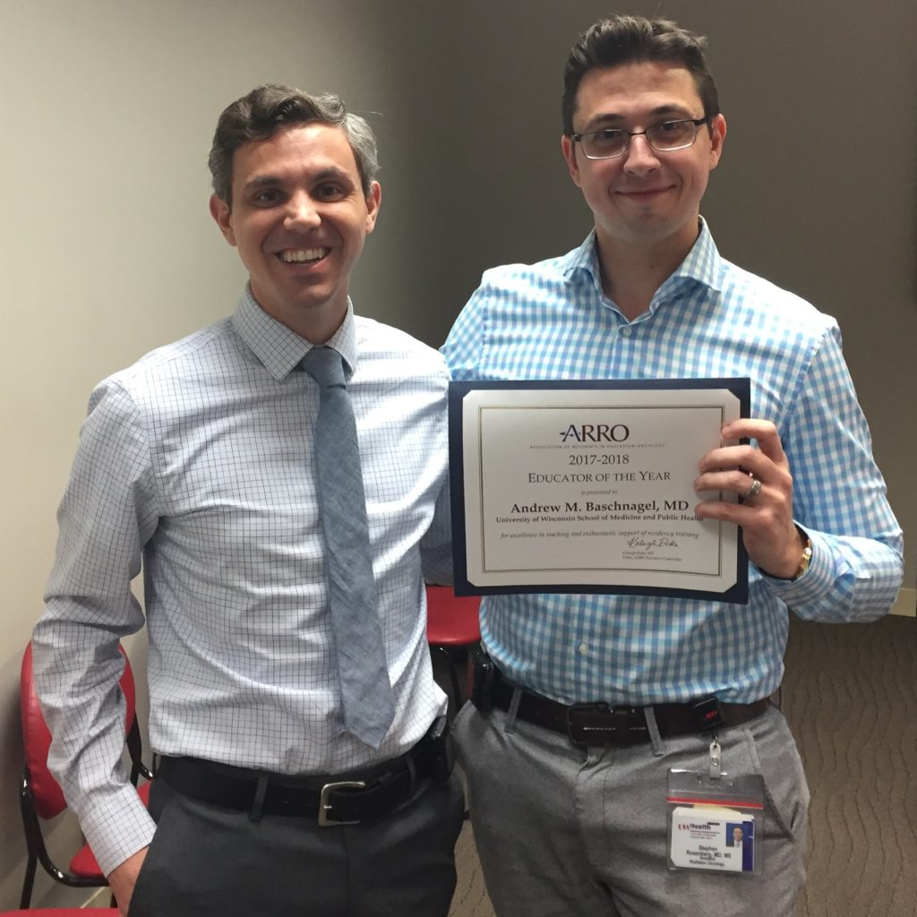 Dr. Andrew Baschnagel, DHO assistant professor, receives ARRO Educator of the Year award from Dr. Stephen Rosenberg, DHO chief radiation oncology resident.