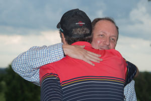 Randy Eggert embraces Paul Harari