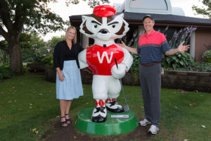 Jill Schmitz and Paul Harari with Bucky the Golfer