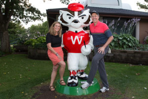 Sarah and Paul Harari with Bucky the Golfer
