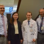 Howard Bailey, director of UW Carbone Cancer Research Center with Kristine Donahue, biology graduate student, Jacob Witt, UW radiation oncology resident and SMPH Dean Robert Golden