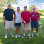2019 Heads Up! Golf Outing participants on the course