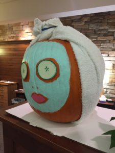 2019 pumpkin decorated at person with facial cream