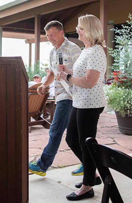 Dr. Greg Hartig and Teal Banbridge walk to the podium at 2021 Heads Up! Golf Outing